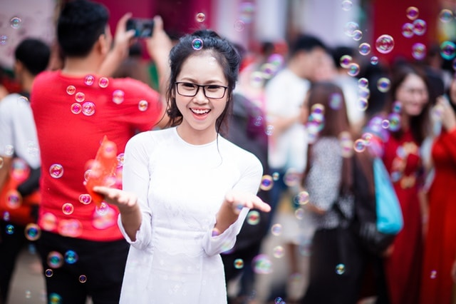 happy asian woman with bubbles