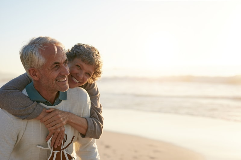 mature couple smiling on beach
